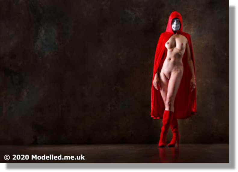 There is no hidding Rosemarie's talent behind the mask in this elegant Red Riding Hood photo session