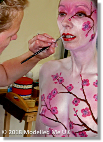 Subtle oriental body painting of Cherry blossom at the hands of the renowned Emma Cammack